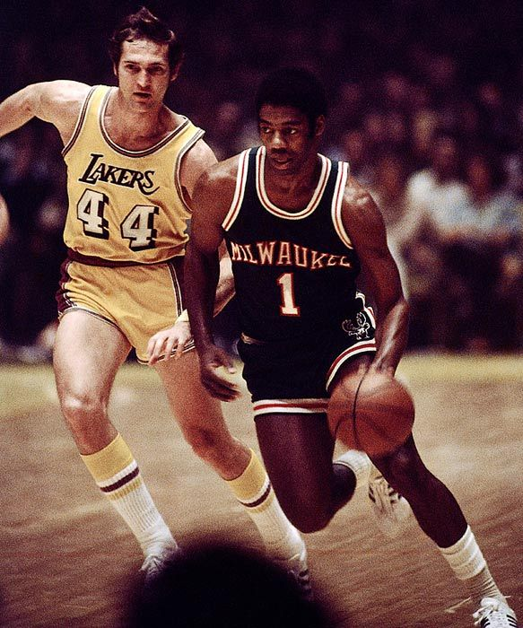 Oscar Robertson dribbling past Jerry West