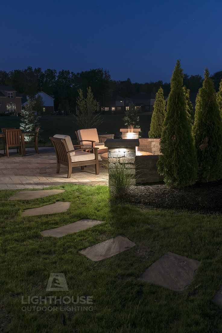46 best outdoor landscape lighting ideas for your home images on subtle lighting around this fire pit invites you to come and enjoy the warmth hardscape mozeypictures Image collections