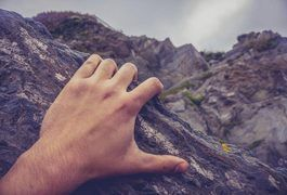 Rock climbing helps improve your cardiovascular system and strengthen your muscles. Crimping is a climbing hold on a small but a positive edge that can fit only the tips of your fingers. According to the Rock Climbing for Life website, crimping is the most stressful way to grip a rock. It involves hyper extension of the first joint in your fingers...