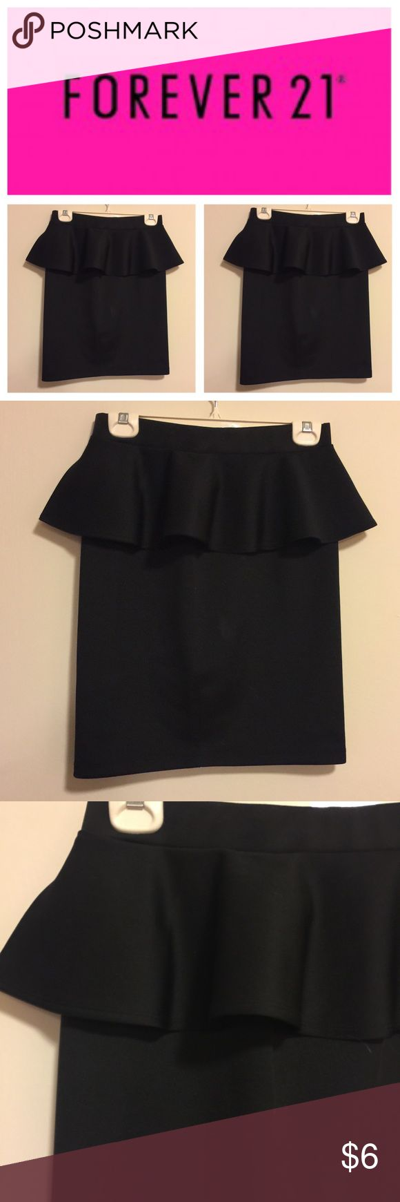 Forever 21 peplum skirt Black. Size large. Never worn. Measures about 21 inches in length. NO TRADES, OFFERS OR MODELING!!! Forever 21 Skirts Pencil