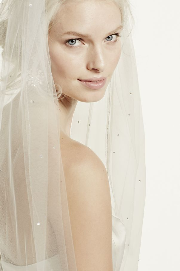 Dramatic and dazzling, this Starry Night inspired cathedral length veil is heavenly.  Adorned with Swarovski crystals, this veil is the definition of romantic.  Measures 120 L x 108 W.  To care f