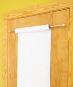 Over-the-door hooks, dowel, roll of paper = instant easel. Perfect for our little house and great for gross-motor!