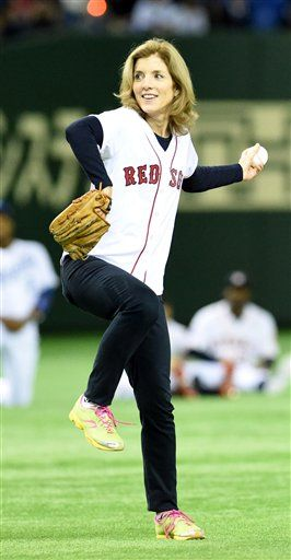 U.S. Ambassasor to Japan Caroline Kennedy throws the ceremonial first pitch before Game 2 of the U.S. Japan Series at Tokyo Dome on Nov. 14, 2014