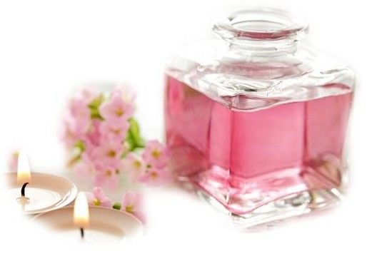 pink perfume bottle, pink flowers and candles
