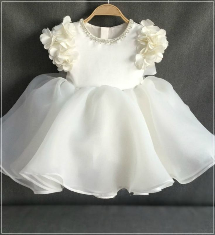 Floral Dress-Made To Order - High Quality Beautiful Beaded Applique Round Neckline Floral Cap Sleeve Tea Length Big Bow Back Baby Infant Toddler Little & Big Girl Flower Dress. Perfect for birthday, wedding, baptism or any special occasion Available from Newborn - 15 Years. Material: Cotton & satin. Color: Off White. Please do compare your little girl measurements with our size chart or you leave a note your little girl's height, bust and waist measurements.