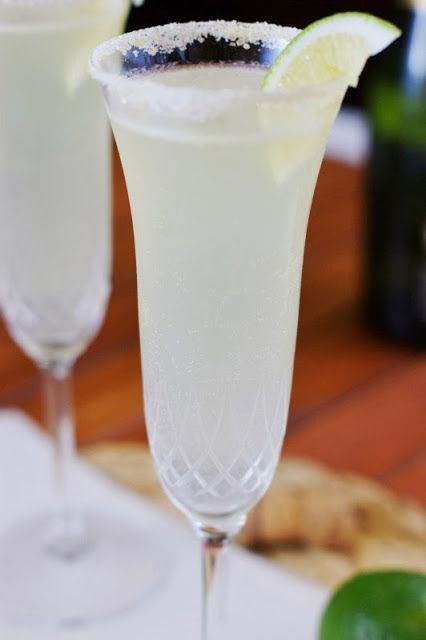 Champagne Margaritas {Happy New Year!} 2 Margaritas:     4 T. Rose's Sweetened Lime Juice     2 oz. Mexican Moonshine SIlver tequila     2 oz. Triple Sec     1 T. fresh lime juice     6 oz. brut champagne/sparkling wine Sugared Rims & Garnish:      About 1 T. turbinado sugar (sugar in the raw)     campaignIcon     About 1 T. granulated sugar     campaignIcon     Lime wedges   Read more at…