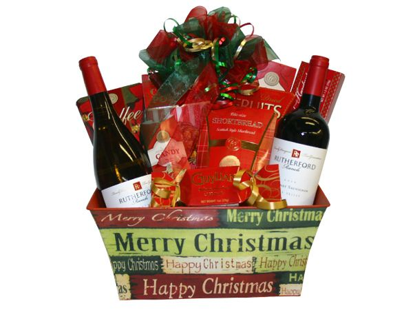 Santa Claus is coming to town...with wine! Send someone special this gift basket with a bottle each of Rodney's Cabernet Sauvignon and Chardonnay, assorted biscotti cookies, shortbread cookies, and chocolates. This gift basket spreads Christmas cheer, and then some!  No Minimums. Contact us to customize the perfect Christmas gift basket to fit your budget.