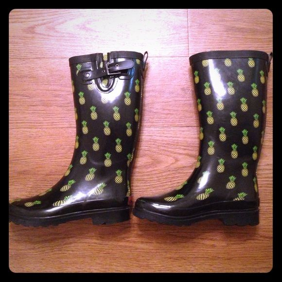 Chooka Pineapple Rain Boots These rain boots are super cute with a pineapple print on black background. There are a few scuffs but they can't really be seen because they're black otherwise they're like new! Chooka Shoes Winter & Rain Boots