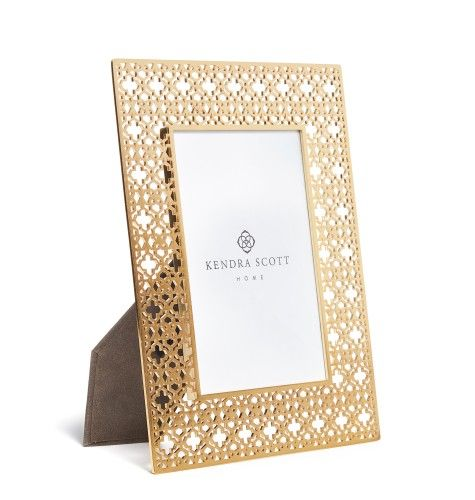 Shop our unique photo frames in bright brass metal filigree. The perfect piece for adding the finishing touch to any room.