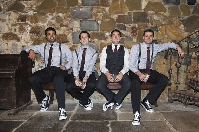 Groom/Groomsmen with suspenders and converse.