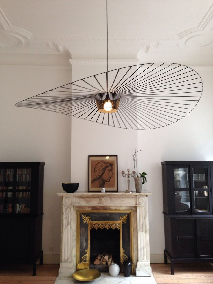 this contemporary light looks amazing in this space it reminds me of the hats people wear on race day.