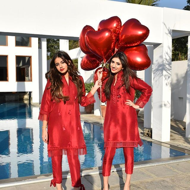 Stunning #NazliAkbarGirls Arooba and Noor are on fire in our #valentinesday #exclusive Ruby Red separates❣️❣️ #GetTheLook from our boutique Mondays to Saturdays from 3 PM - 6 PM or order online via #Instagram or #Facebook. We deliver worldwide.