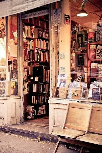 Book Store, Greenwich Village, New York  I would live on that chair outside and never leave.