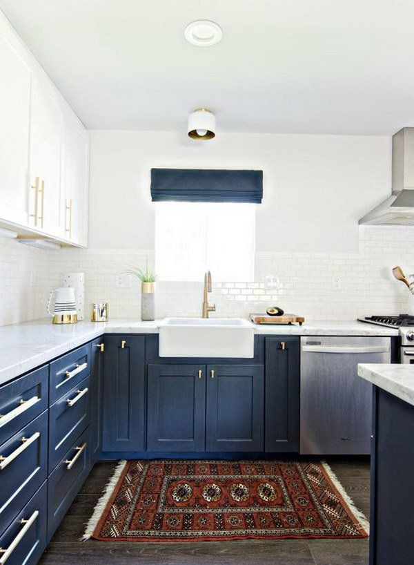 Navy Blue and White Kitchen Cabinets with Gold Hardware.