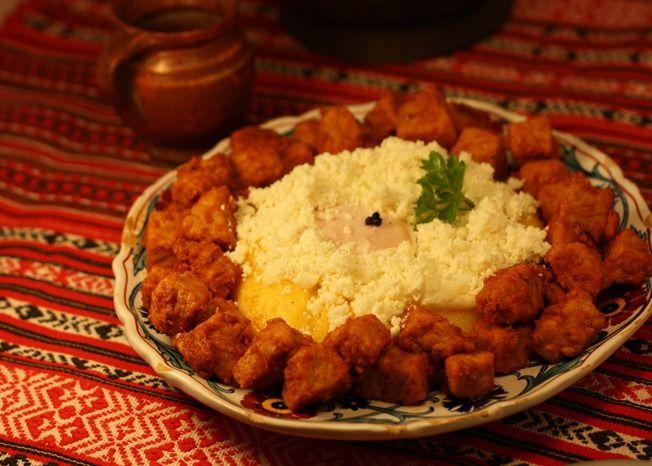 Tochitura moldoveneasca-moldovan tochitura(pan-fried pork served with mămăligă and wine)