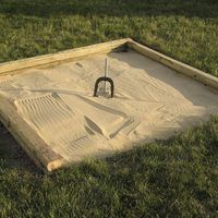 You can easily set up a friendly backyard horseshoe pitching court by simply pounding two stakes in the ground about 40 feet apart. But if you take the game seriously, you'll want to build a regulation-size court with precise measurements, which includes the size of the pit, the sandy area where the horseshoe lands. The National Horseshoe...