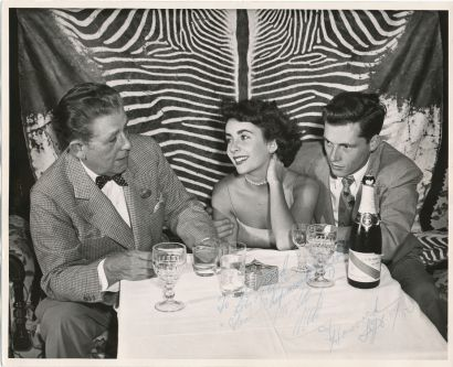 Jerome Zerbe,(official El Morocco photoapher) Elizabeth Taylor and first husband Nicky Hilton at the El Morocco 1950.