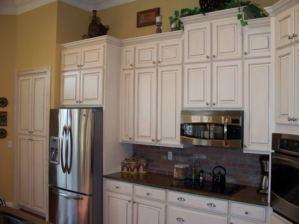 Click to view before and after this kitchen had the for Refinishing kitchen cabinets before and after