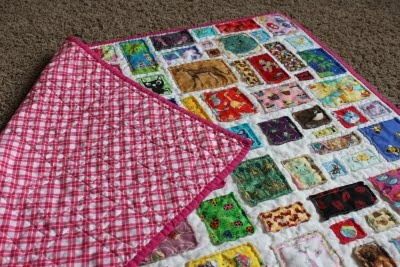 "An ""I Spy"" quilt using fabric scraps.  I could actually DO this!  Small, of course. :)"
