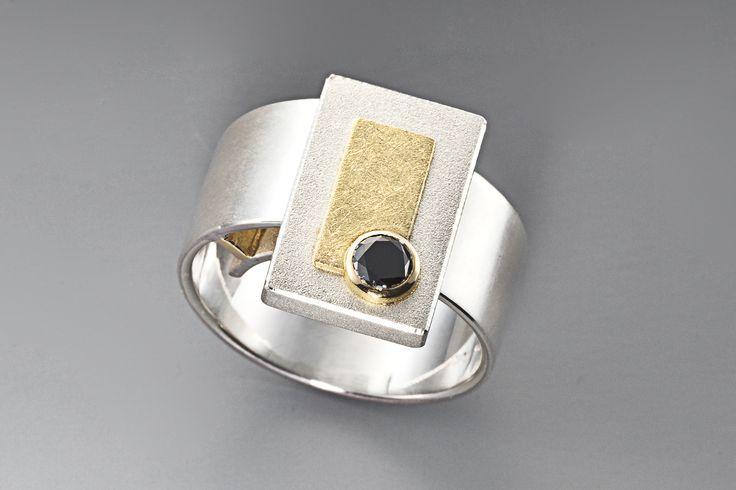 Ring  Sterling silver, 18 carat gold, black diamond