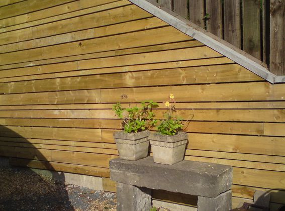 Covering a concrete retaining wall general cover for - How to cover exterior cinder block walls ...