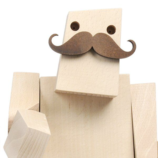 """Woodstaches - Grave A robot for decor... Forget that cliché of the cold robot! These friendly characters are real attention-getters, ready to bring a warm and amusing touch to your decor. """"Grave"""" is the smallest of our three men with moustaches."""