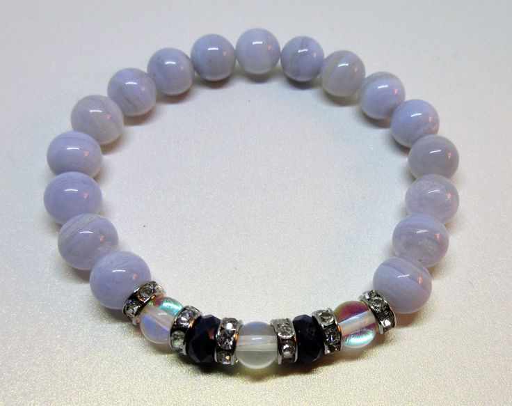 Blue Lace Agate  stretch bracelet  with faceted Sapphire . Sapphire is a birth stone for September, it is known as a symbol of wisdom and spiritual enlightenment....