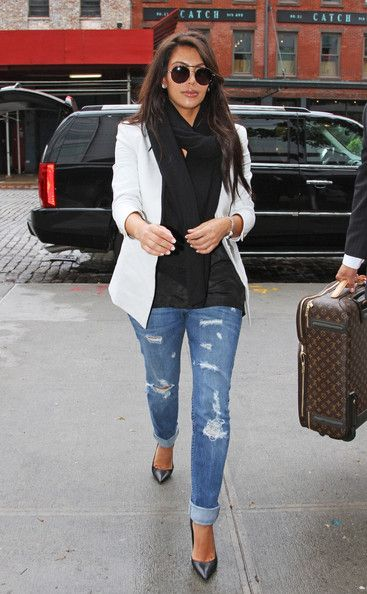 torn skinny jeans and a sophisticated blazer