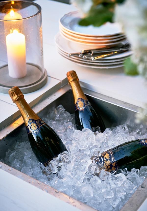 Oxnö table 160 cm with champagne cooler. Design: Matilda Lindblom. Photo: Johan Carlson