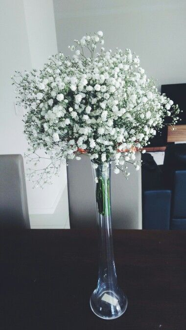 Decorations for the wedding church:- Baby's breath that I bought from a local flowers market and arranged to fit the vases