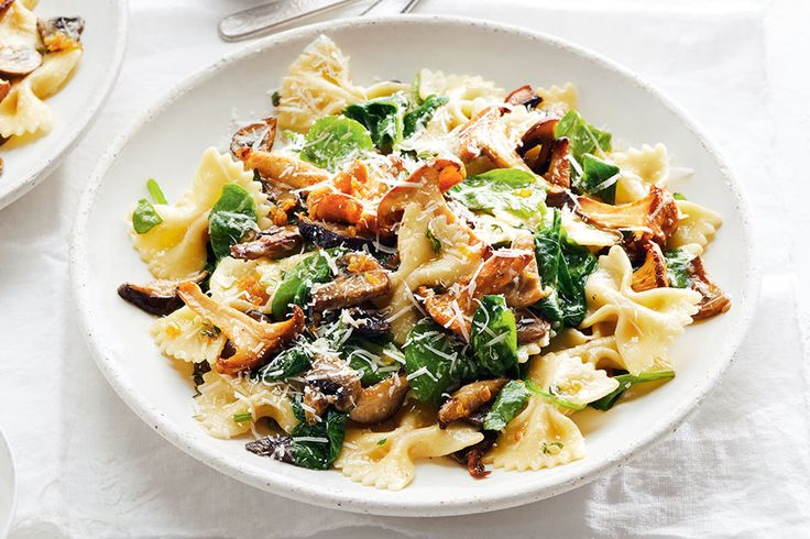 Bow tie pasta gets a sophisticated update with white wine, mushrooms and spinach. | Image: Maya Visnyei | Food styling: Claire Stubbs | Prop styling: Lara McGraw