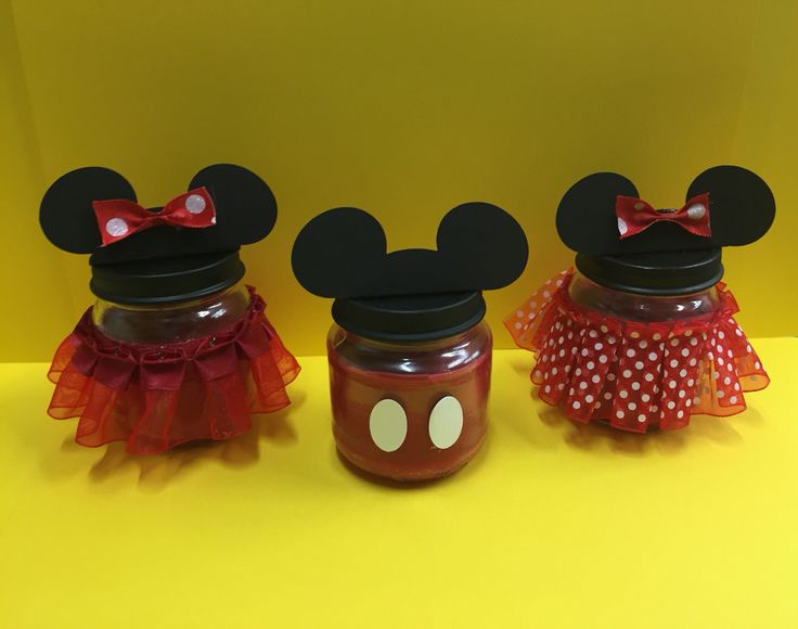 Mickey Mouse and Minnie Mouse candles in gerbers jars as party favors