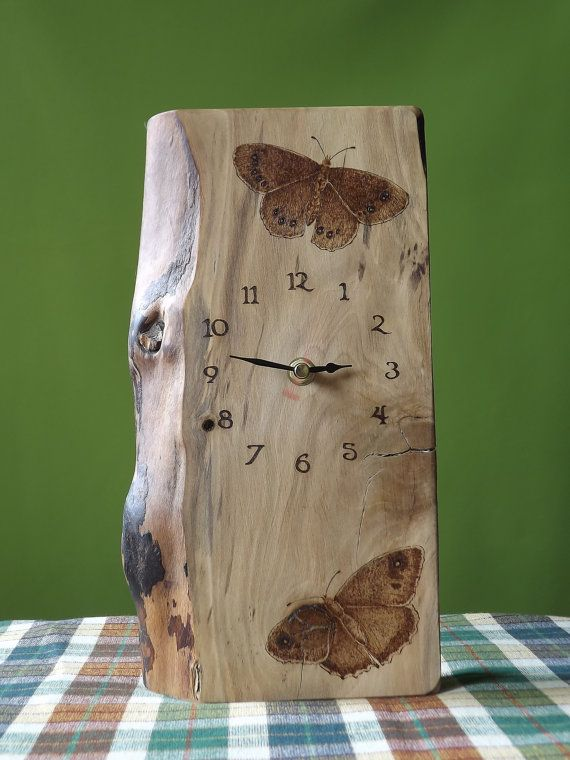 Wooden Clock Hand made, not butterflies though maybe wolves and then the name of the state like COLORADO