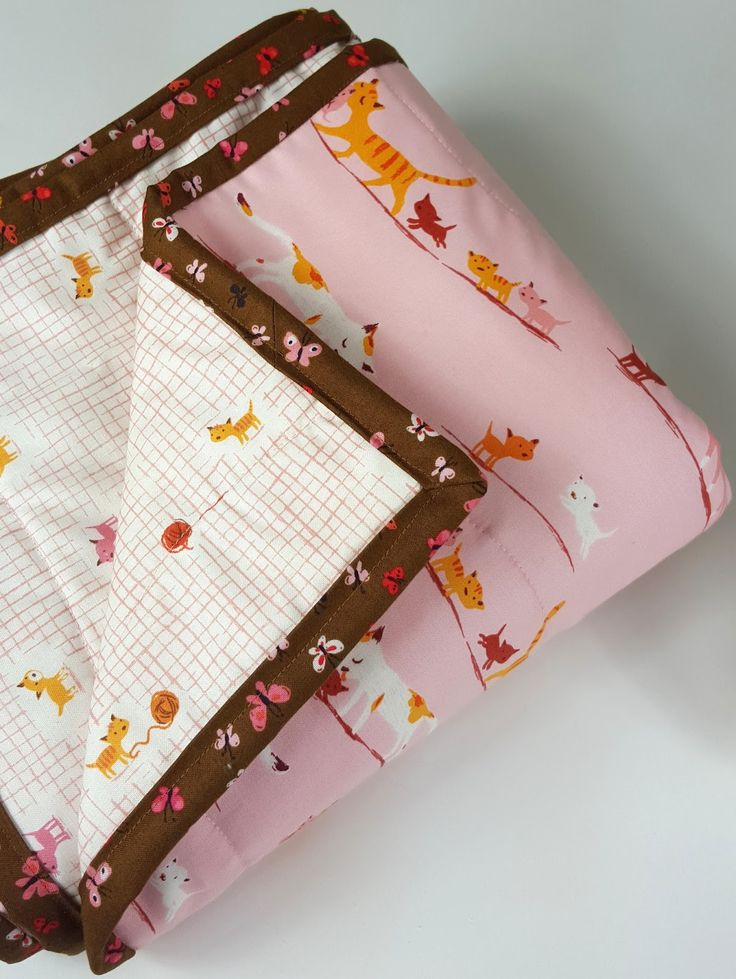 Melissa's 2 Hour Bound Whole Cloth Quilt   Made with Tiger Lily by Heather Ross      It's time for another tutorial! Recently, I had one w...