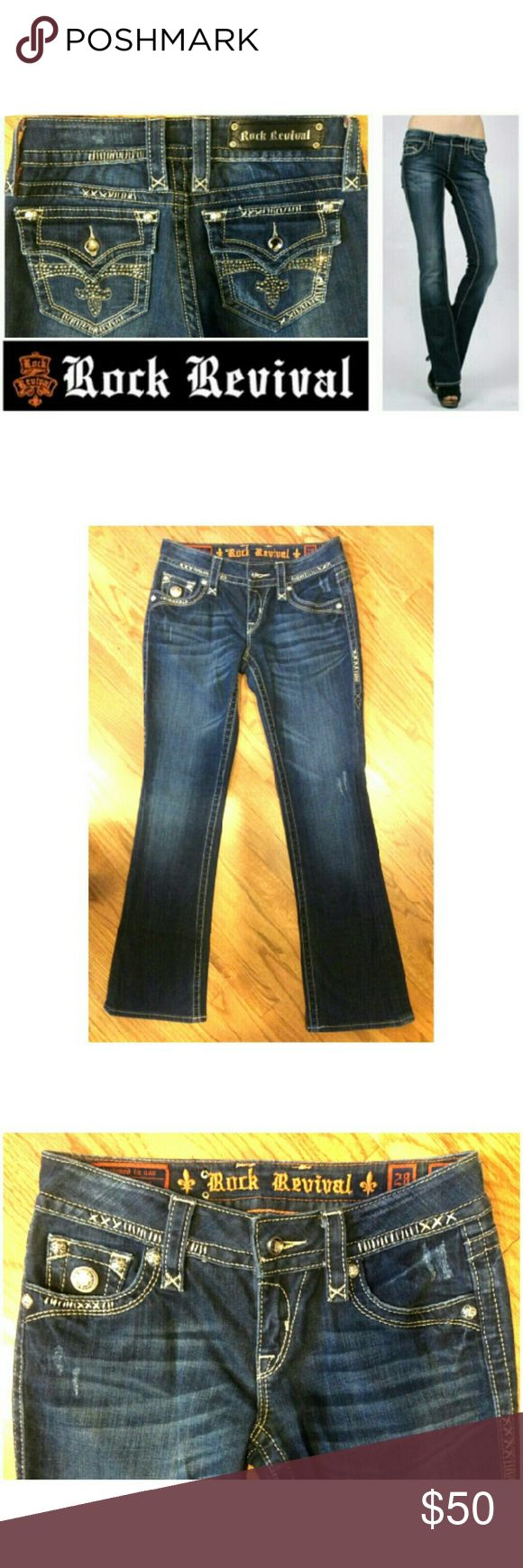 """🔥73%off Celine Boot Rock Revival jewel Cross jean These gorgeous Rock Revival Celine Boot jeans are perfect for dressing up any casual occasion! Medium royal blue denim wash in cotton blend with 2% spandex for stretch fit. Traditional 5 pocket style, stitching elegantly decorates throughout, Rock Revival logo stud on 5th pocket and crystal crosses on buttoned back pockets. Rock Revival leather tag logo on back. Size 28, 31"""" inseam. In EXCELLENT CONDITION. Dress up or down with sweaters and…"""