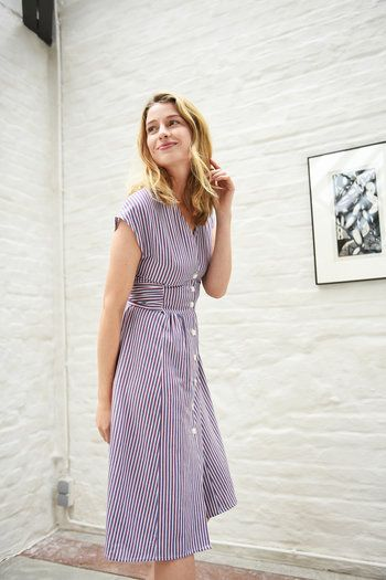 joanne is a tailored button down dress featuring an a line skirt and