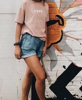 Blush tee with denim shorts.
