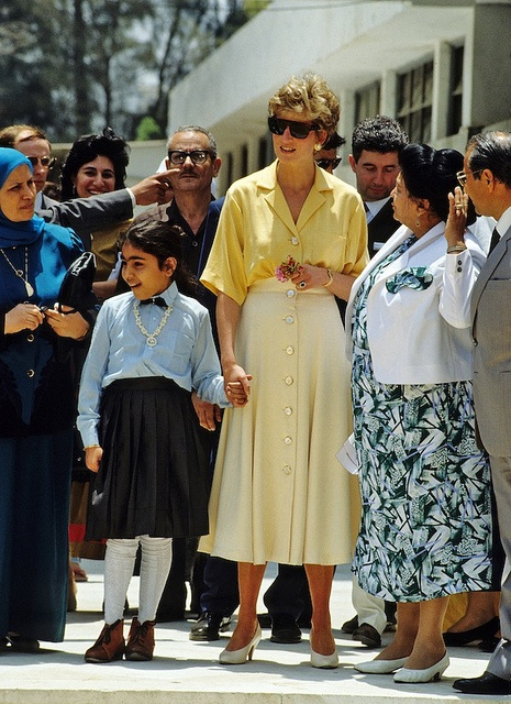 Princess Diana holds the hand of a ten year old polio sufferer,  Heba Salah, when she visited the Institute of Polio & Rehabilitation in Cairo, Egypt on May 12, 1992