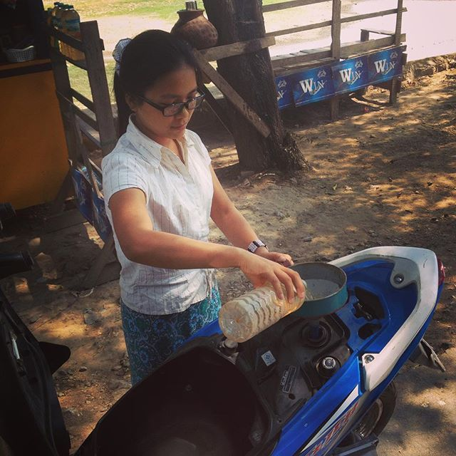 """This is exactly what it looks like: I'm getting my #Honda refuelled with #gasolina from a used water bottle, at a stall by the side of the road 🏍⛽️ #daddyyankee #notsurehemeansthesamething #songoftheday #stuckinyourhair #scooterlife #scooterboy #myanmar #burma #amarapura #southeastasia #wanderlust #travelgram #instatravel #sabbaticallife #sabbatical #nowork #enjoylife"" by (sabbatical.life). sabbaticallife #nowork #wanderlust #gasolina #scooterboy #travelgram #enjoylife #daddyyankee #burma…"