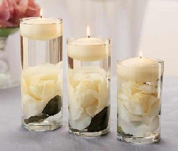 Submerged white roses with a floating candle