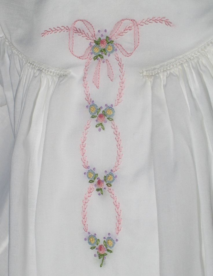 Pink featherstitching & shadow work combined with bullion roses, French knots and lazy daisies.  Made by Trudy Horne.