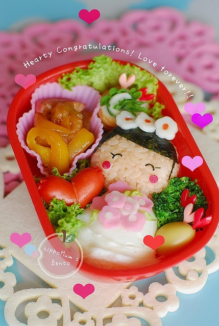A happy bride bento box, beautifully decorated with lashings of translucent heart stamps and a sprinkling of Engrish. :3
