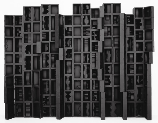 Louise Nevelson. The artist would walk the streets of NYC and trash pick wooden objects for her assemblages.