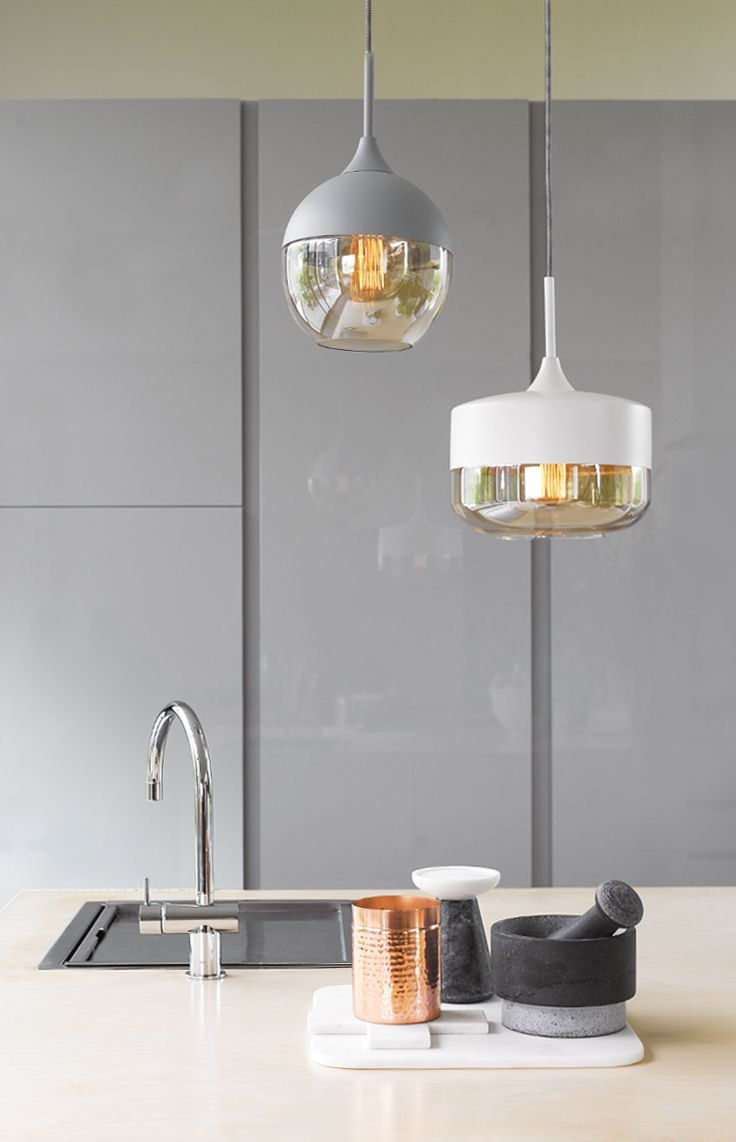Lunar 1 light round pendant in grey with amber glass and 1 light bowl pendant in white with amber glass.