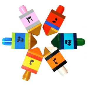I know, I know…Halloween is not even here and already we're diving headfirst into holiday picks. But it's hard to resist when it's a Hanukkah goodie as cool as these dreidels. [find out how to get a great limited time discount after the jump!] Made by artist Val Glaser, who does all kinds of cool …