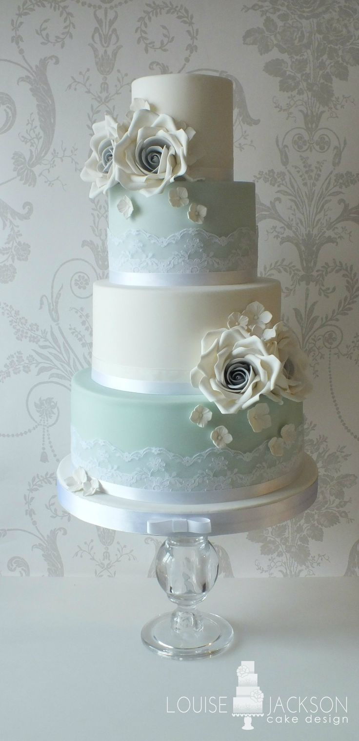 Vintage style wedding cake in duck egg blue, dove grey and white