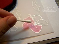 stamp your images onto your vellum paper and heat emboss them with white powder. After they have cooled choose your ink colors and color your image with a q-tip