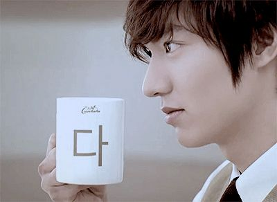 [GIF] Lee MinHo for Cantata. That is way too cute. Lucky cup