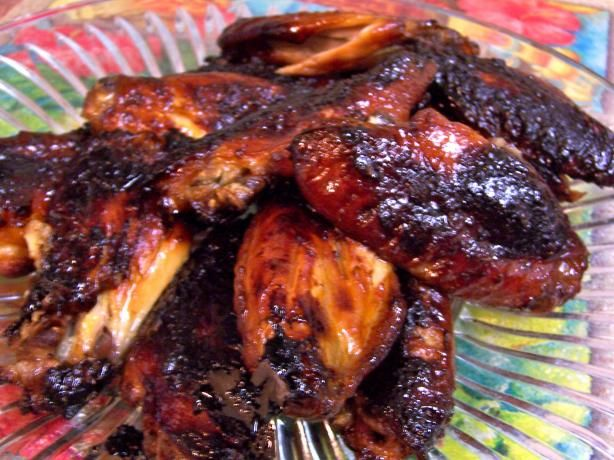 Easy Mahogany Chicken Wings from Food.com: These wings are a Big Hit, Everyone gobbles them up. They are so easy to make and are perfect for BBQ's and Potlucks. They are called mahogany chicken wings, because after cooking, they turn a deep mahogany color from the caramelized marinade coating. Don't shy away from the spices, they add flavor and not too much heat. Enjoy!