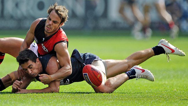 Sam Lonergan tackles Andrew Carrazzo, resulting in a break to the Carlton tagger's shoulder blade. Essendon went on to defeat Carlton in round 4 by 5 goals in an upset win that kept the Bombers undefeated in 2012.